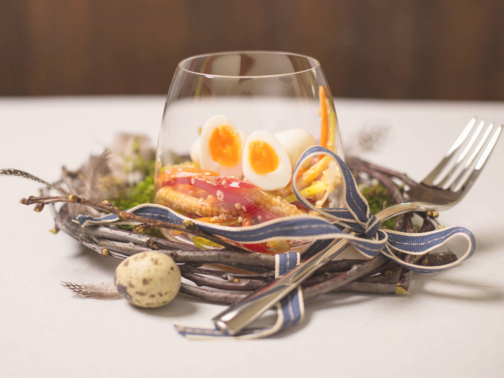 Quail eggs in a glass
