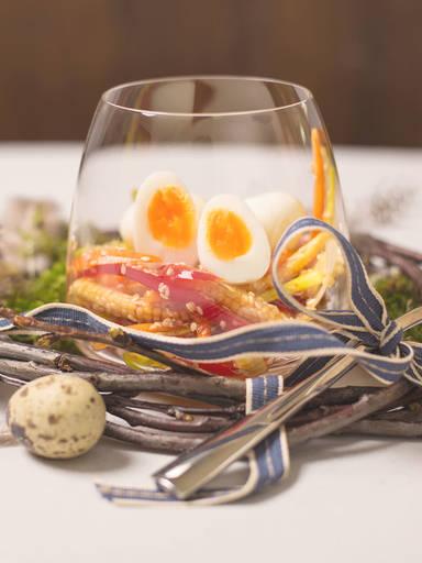 Quail eggs in a glass
