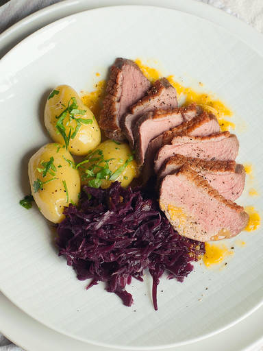 Roast duck with red cabbage and new potatoes