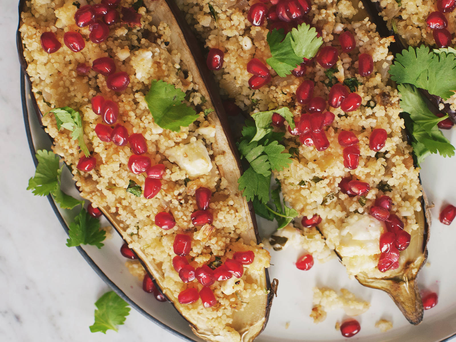 Pomegranate and couscous stuffed eggplant