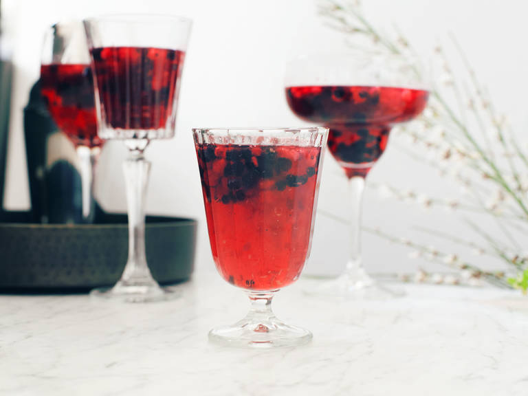 Refreshing prosecco creation with red berries