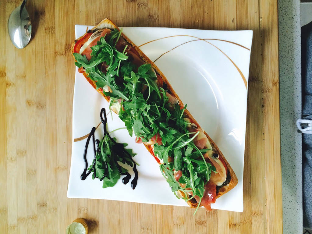 Ciabatta Caprese with prosciutto and arugula