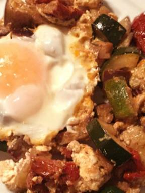 Greek-style fried vegetables with feta and egg