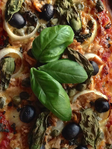 Pizza with capers, tuna, and olives