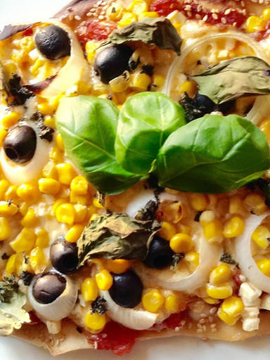 Pizza with sweetcorn, olives, and feta
