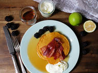 Pumpkin pancakes with bacon and blackberries