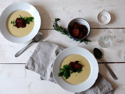 Vegetarian parsnip soup with beetroot chips