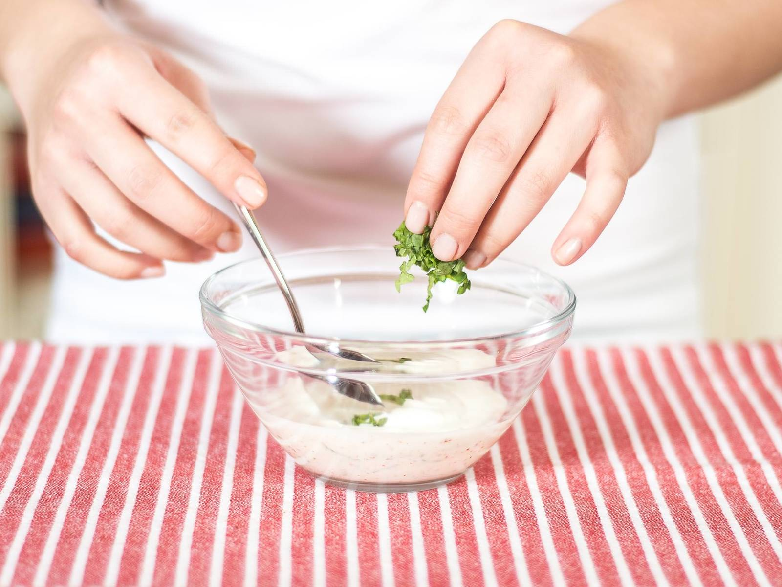 For the mint yogurt, mix natural yogurt with confectioner's sugar and the lime juice. Cut the mint leaves into thin strips and fold into the yogurt.