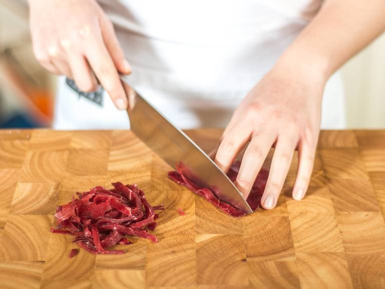 Cut bresaola into thin strips, approx. 0.5 cm wide.