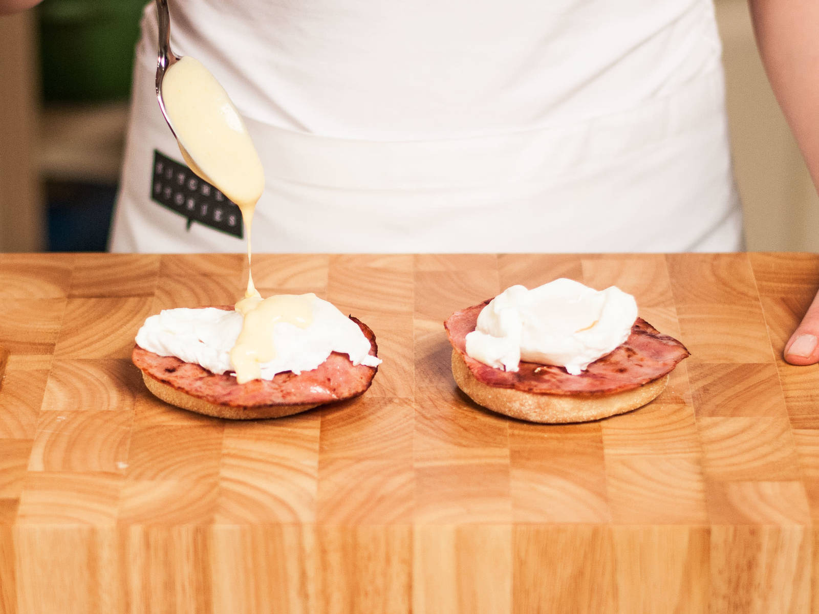 Halve English muffins, top each with a slice of ham and a poached egg. Sprinkle with some salt and warm hollandaise sauce.