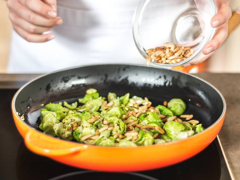 As soon as Brussels sprout leaves have slightly softened (after approx. 2 - 3 min.) add the pine nuts and roast for an additional 1 – 2 min.