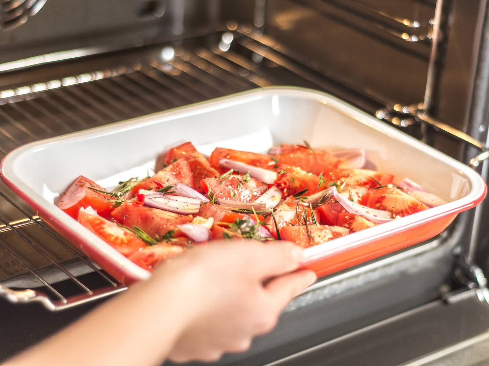 Place the shallots, garlic, tomatoes, thyme, rosemary, and chili into a baking dish. Season with olive oil, sugar, salt, and pepper and mix well. Roast in a preheated oven at 200°C/400°F for approx. 20 – 25  min.
