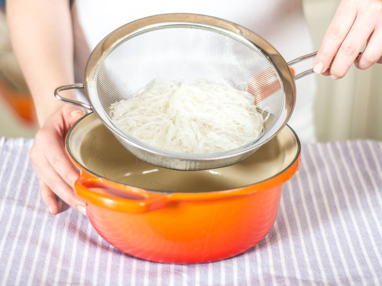 Drain glass noodles and briefly rinse under cold water. Cut shorter with a knife if desired.