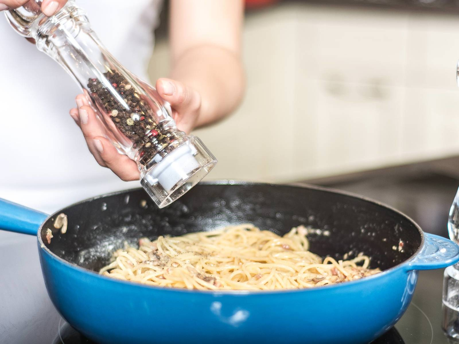 Toss spaghetti in the sauce. Add Parmesan, toss again, and season with salt and pepper to taste before serving.