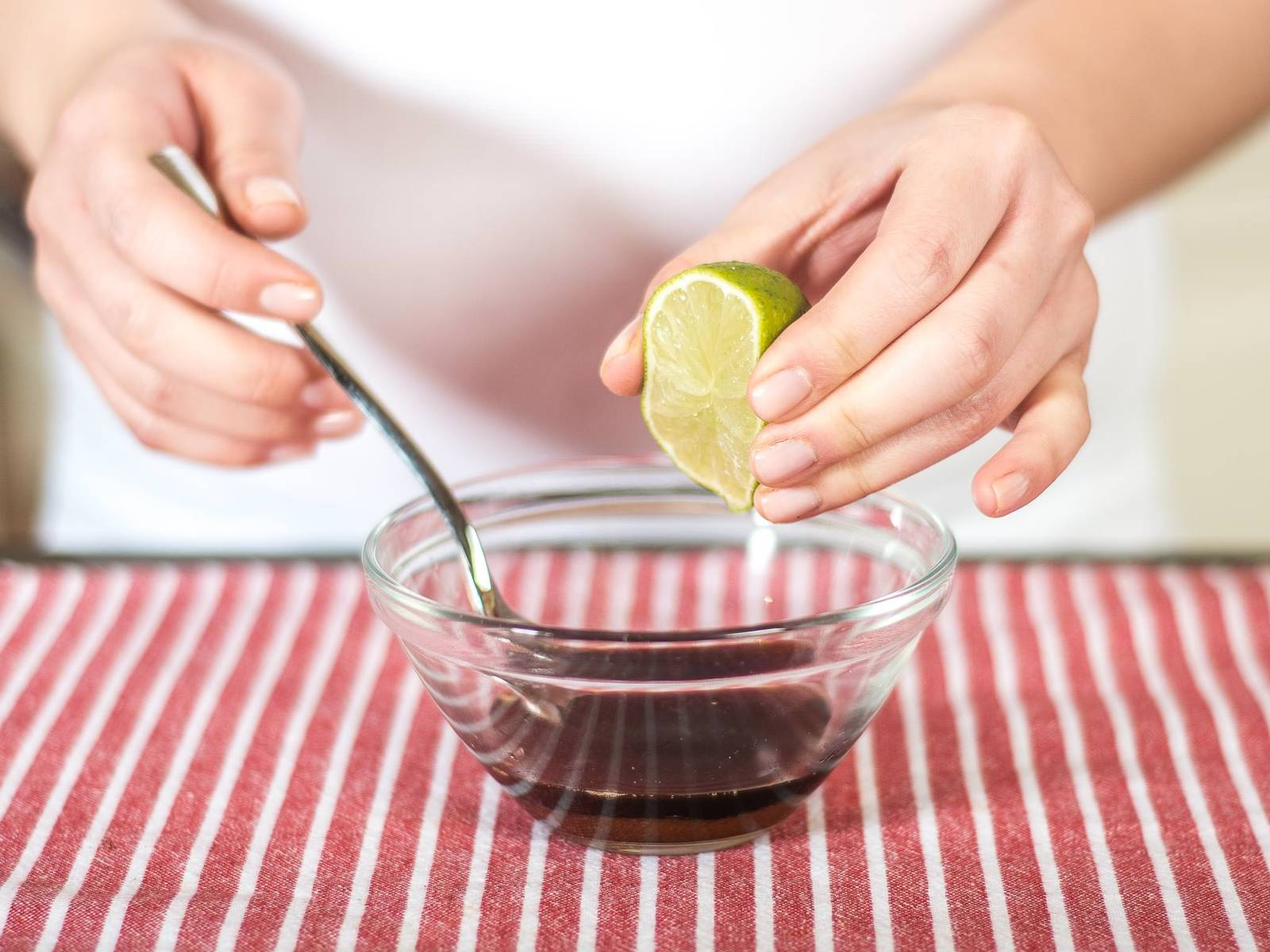 Mix fish sauce, soy sauce, brown sugar, and lime juice together in a small bowl.