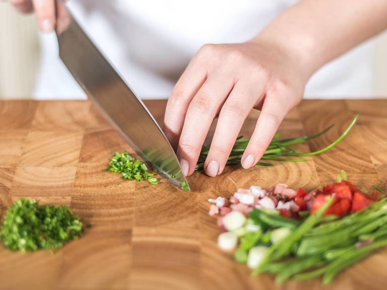 Preheat the oven to 180°C/350°F. Finely dice bacon and pepper. Slice green onions into fine rings and sugar snap peas into thin strips. Finely slice chives.