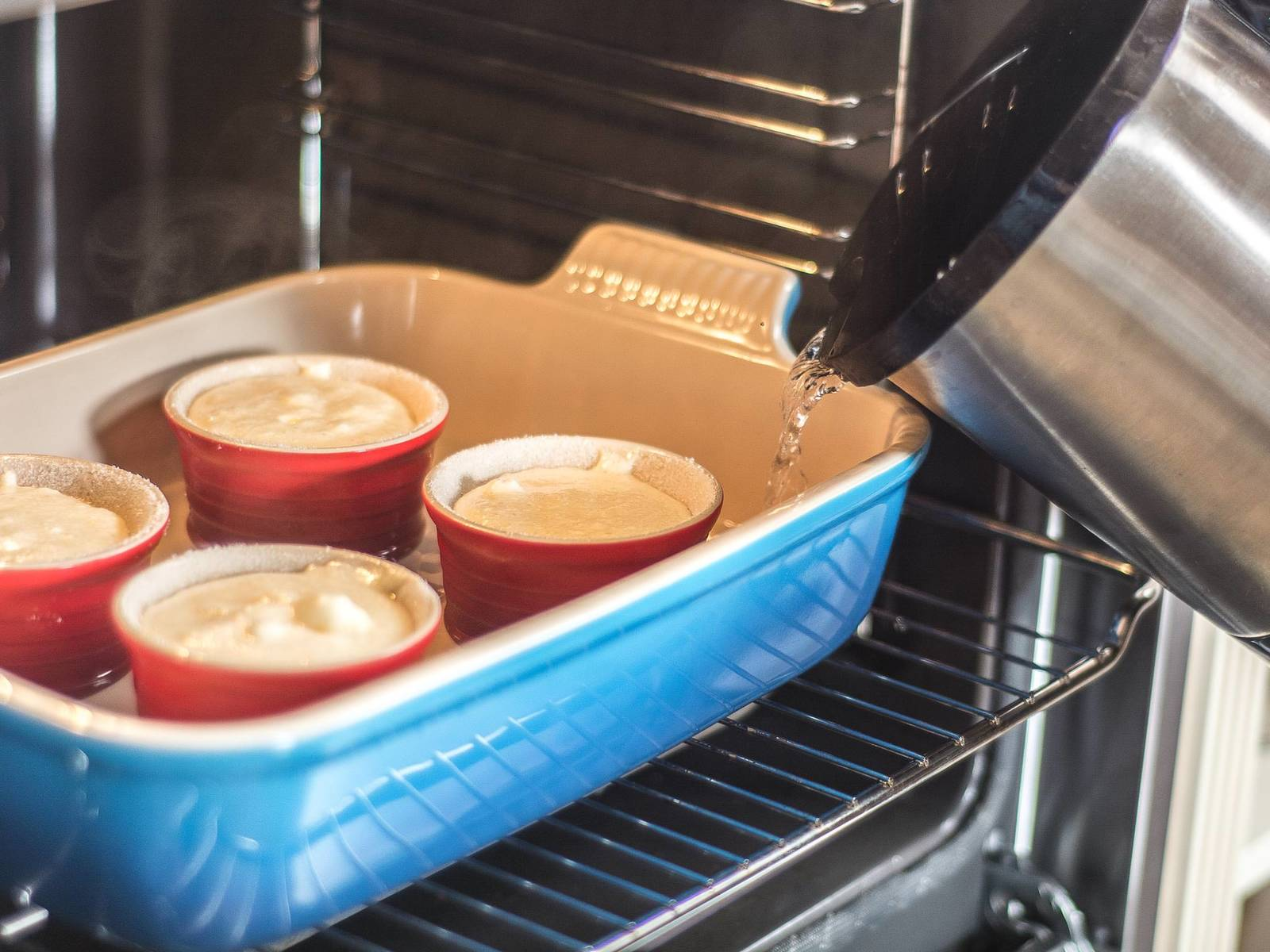 Bake soufflés in a water bath in a preheated oven at 180°C/ 355°F for approx. 22 - 25 min. Serve immediately after baking, as the soufflé might sink. Garnish with confectioner's sugar.