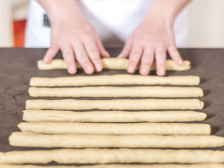 Roll into thin sticks on a work surface. One batch of dough should be enough for 10 to 15 grissini.