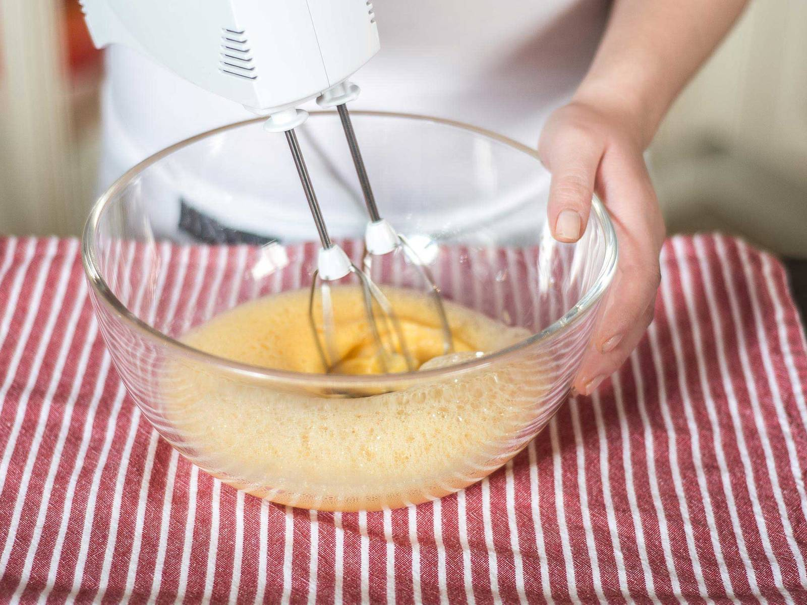Beat eggs and egg yolks with hand mixer until fluffy.