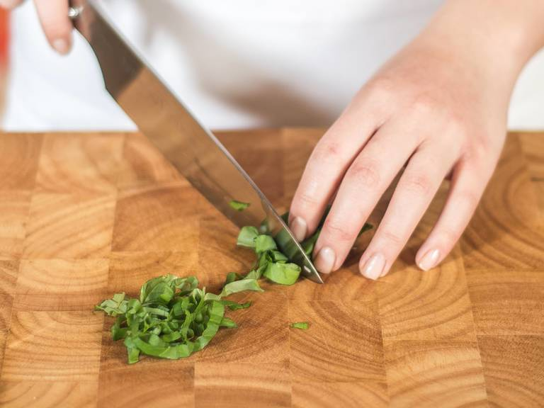 Cut basil into fine strips.