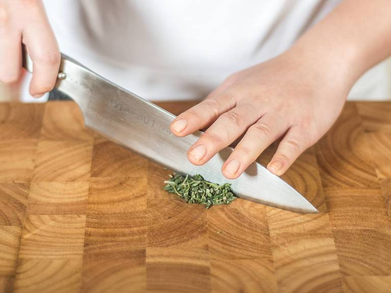 Meanwhile, finely chop rosemary and thyme.