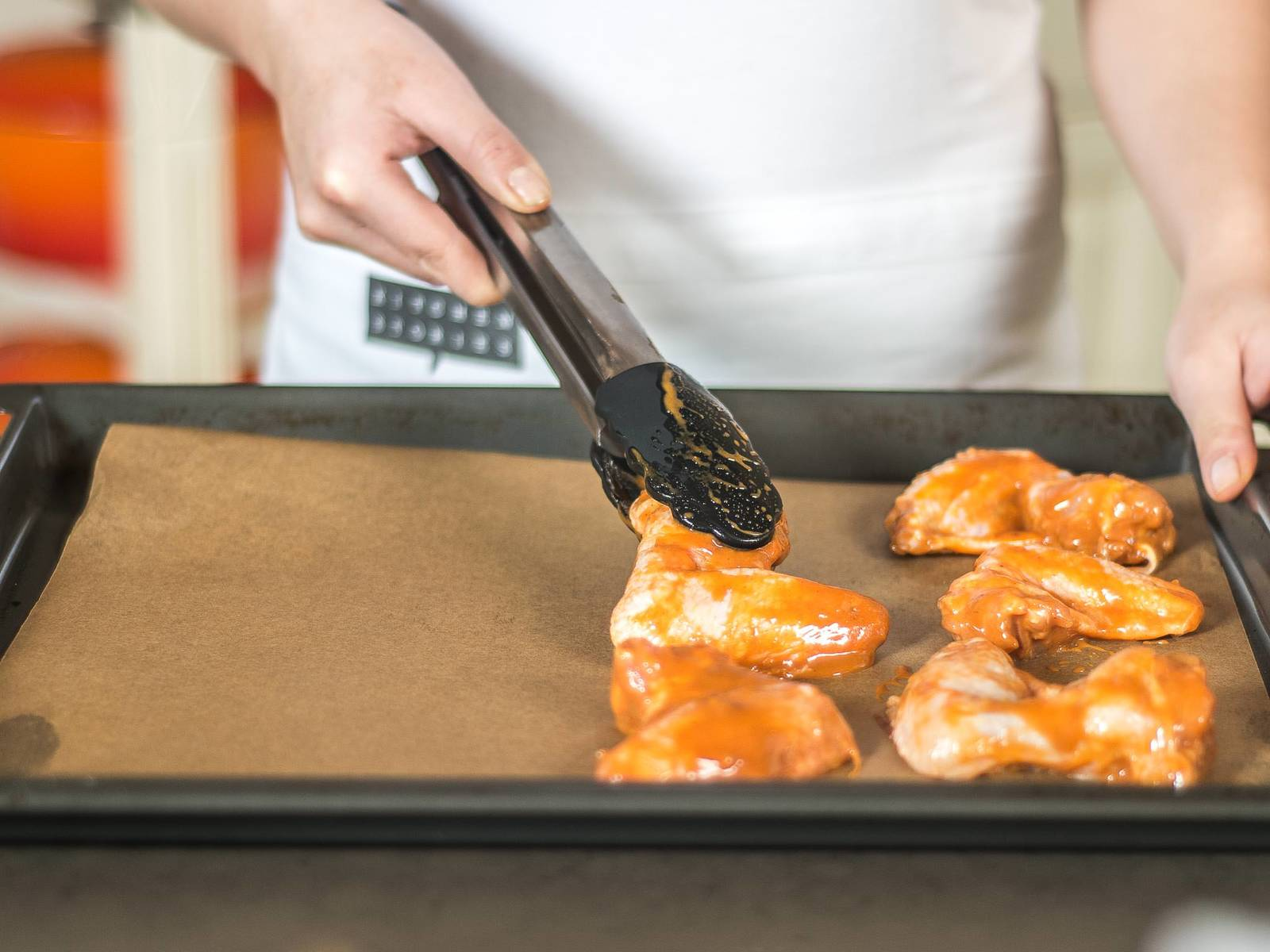 Preheat the oven to 180°C/355°F. Now, take the marinated chicken wings, allowing any surplus marinade to drip off, and put on a baking rack or a baking sheet lined with parchment paper.