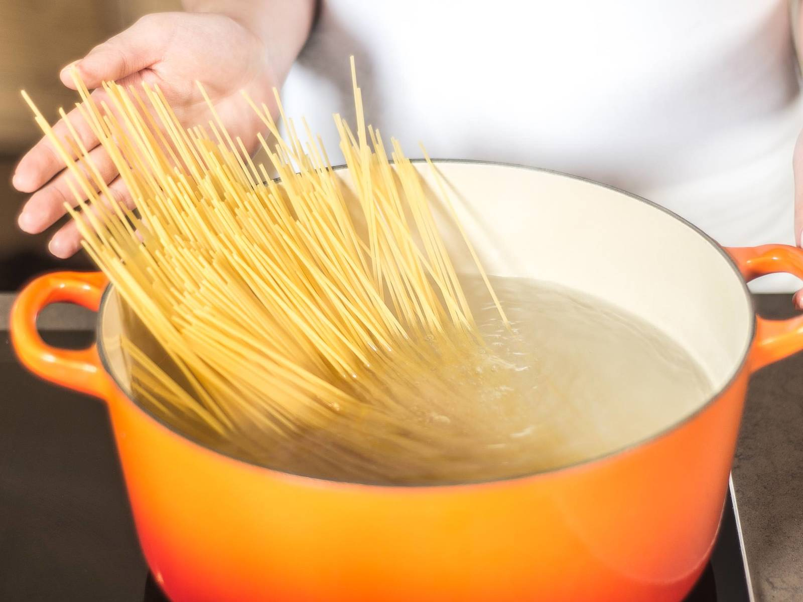 Cook spaghetti in salted, boiling water according to package instructions, until al dente. Drain and set aside.