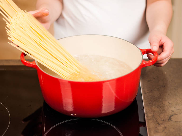 Cook pasta in plenty of salted, boiling water according to package instructions for approx. 10 – 12 min. until al dente. Drain, save some pasta water and set aside.