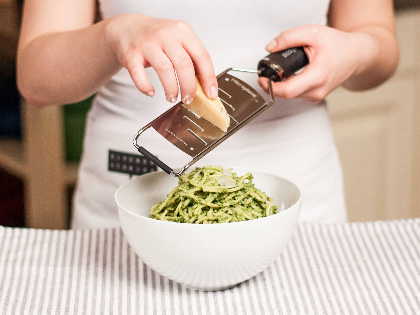 In a large bowl, combine cooked pasta with yogurt-pesto. If the pasta seems too dry, add some of the previously saved pasta water. Serve with shavings of Parmesan cheese.