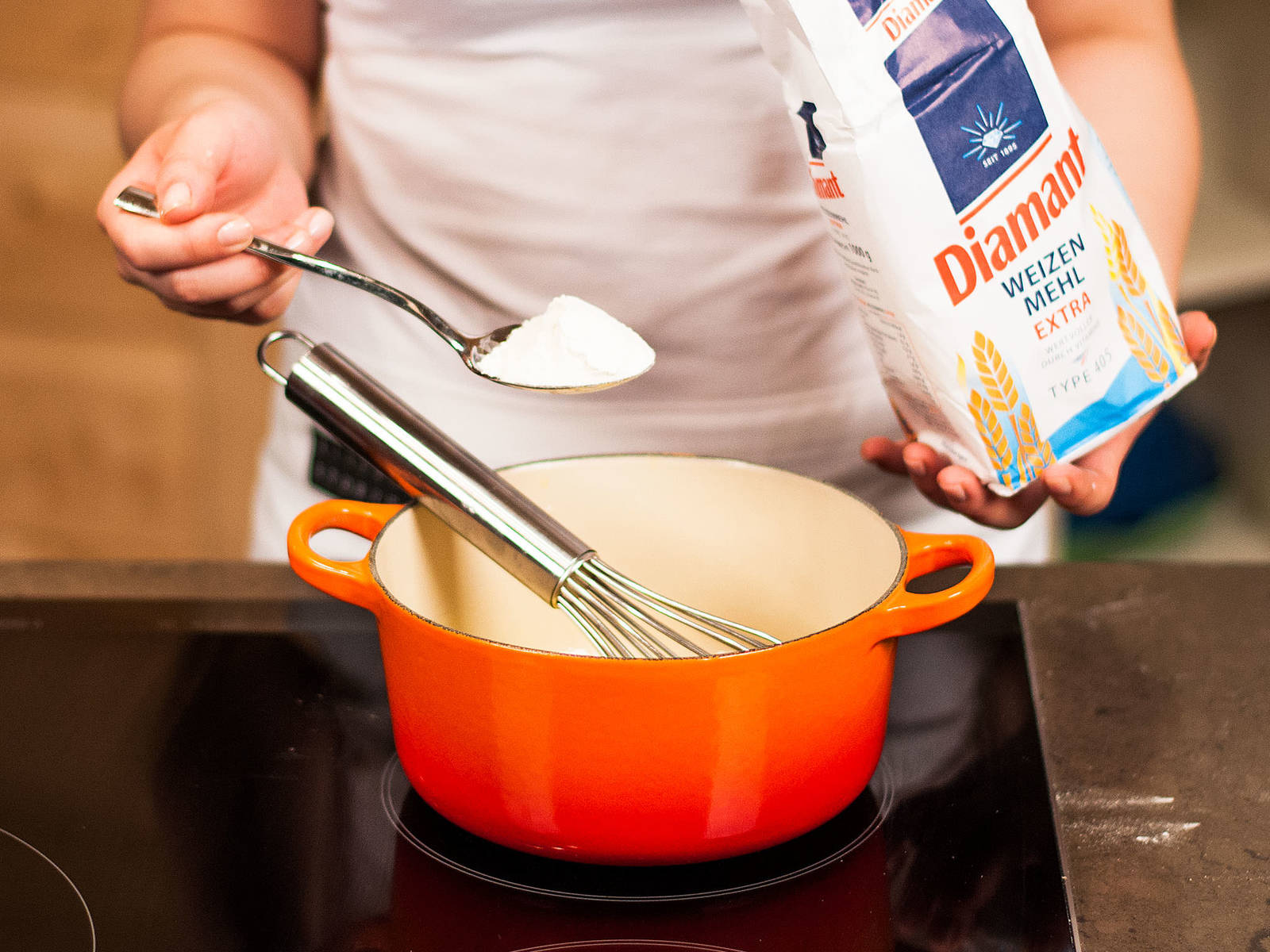 Prepare a roux for the cream sauce. Melt butter in a saucepan, add flour, and stir constantly until there are no more lumps.