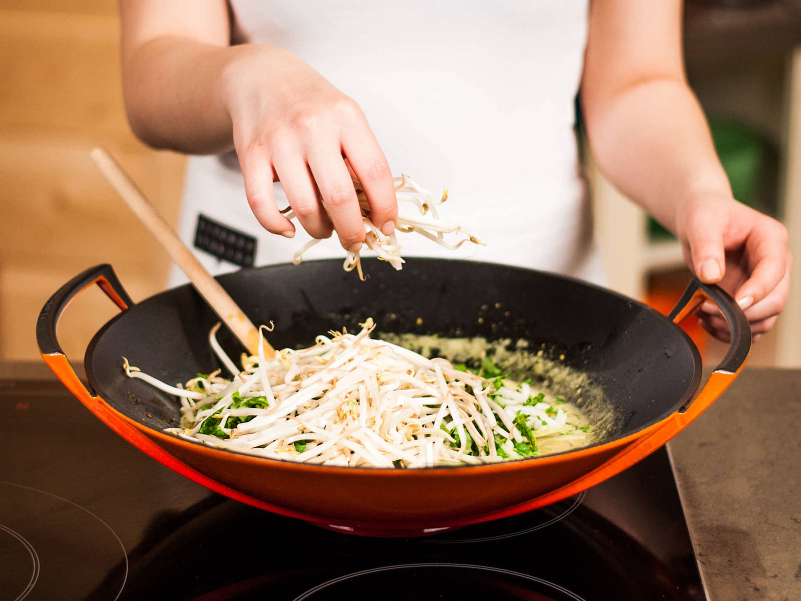 Add coconut milk, lemon grass, bok choy, and soybean sprouts. Allow sauce to reduce over medium-high heat until slightly thickened. Stir occasionally.