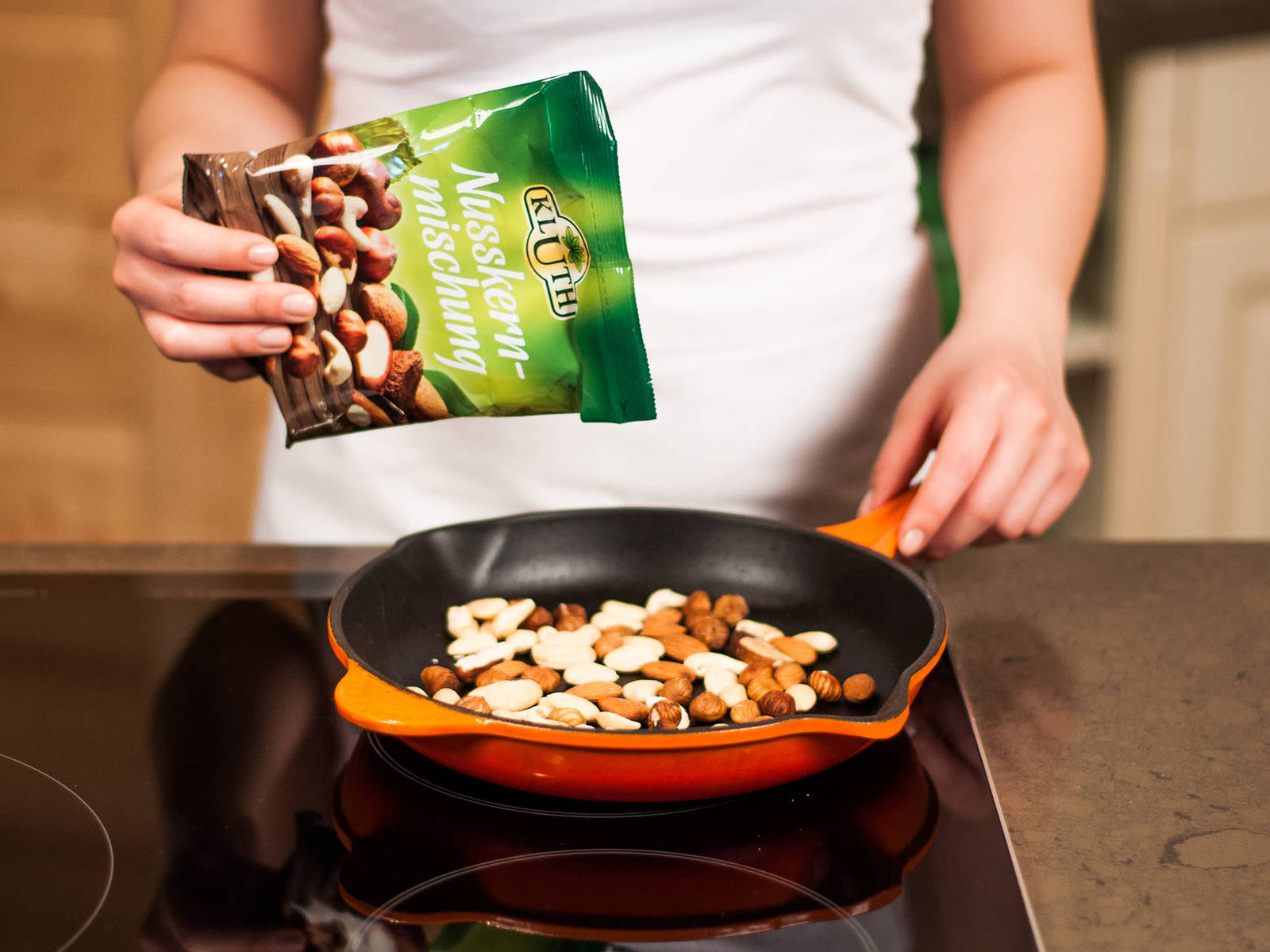 Toast nut mix in a pan until golden brown. A combination of hazelnuts, almonds, cashews, and Brazil nuts works well.