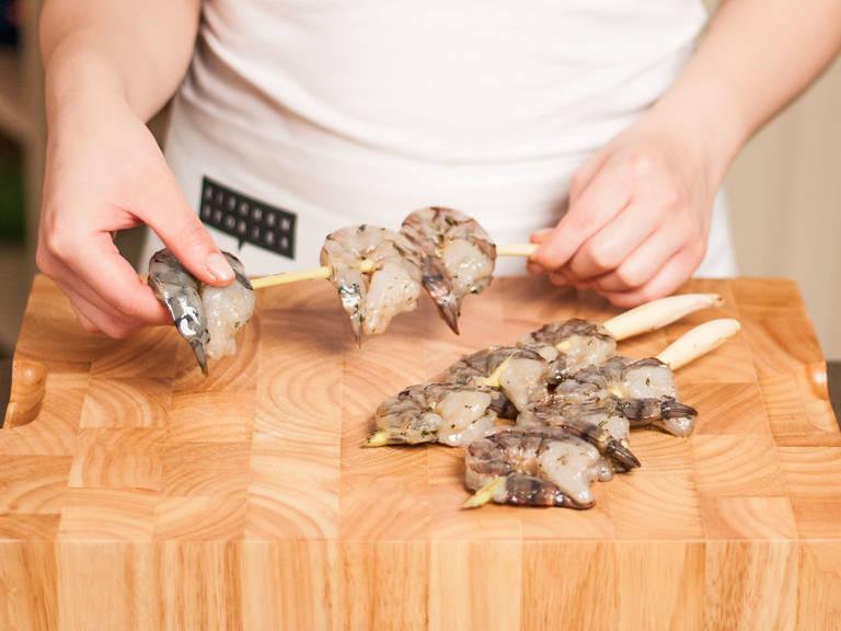 Remove marinated shrimp from the fridge and skewer 3 shrimp on each lemongrass stalk.