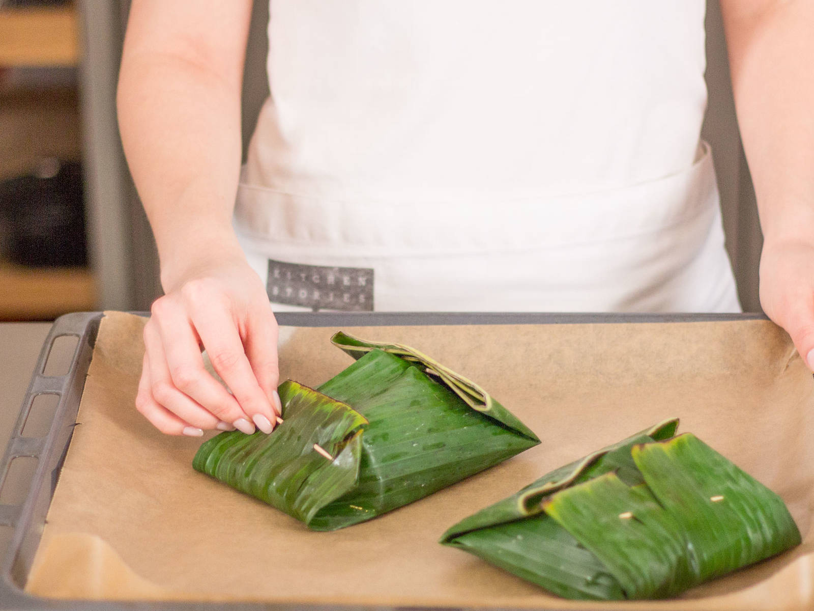 Fold banana leaves until all sides of cod fish are covered. Use toothpicks to secure the leaves. Bake in the oven at 180°C/350°F for approx. 30 min.