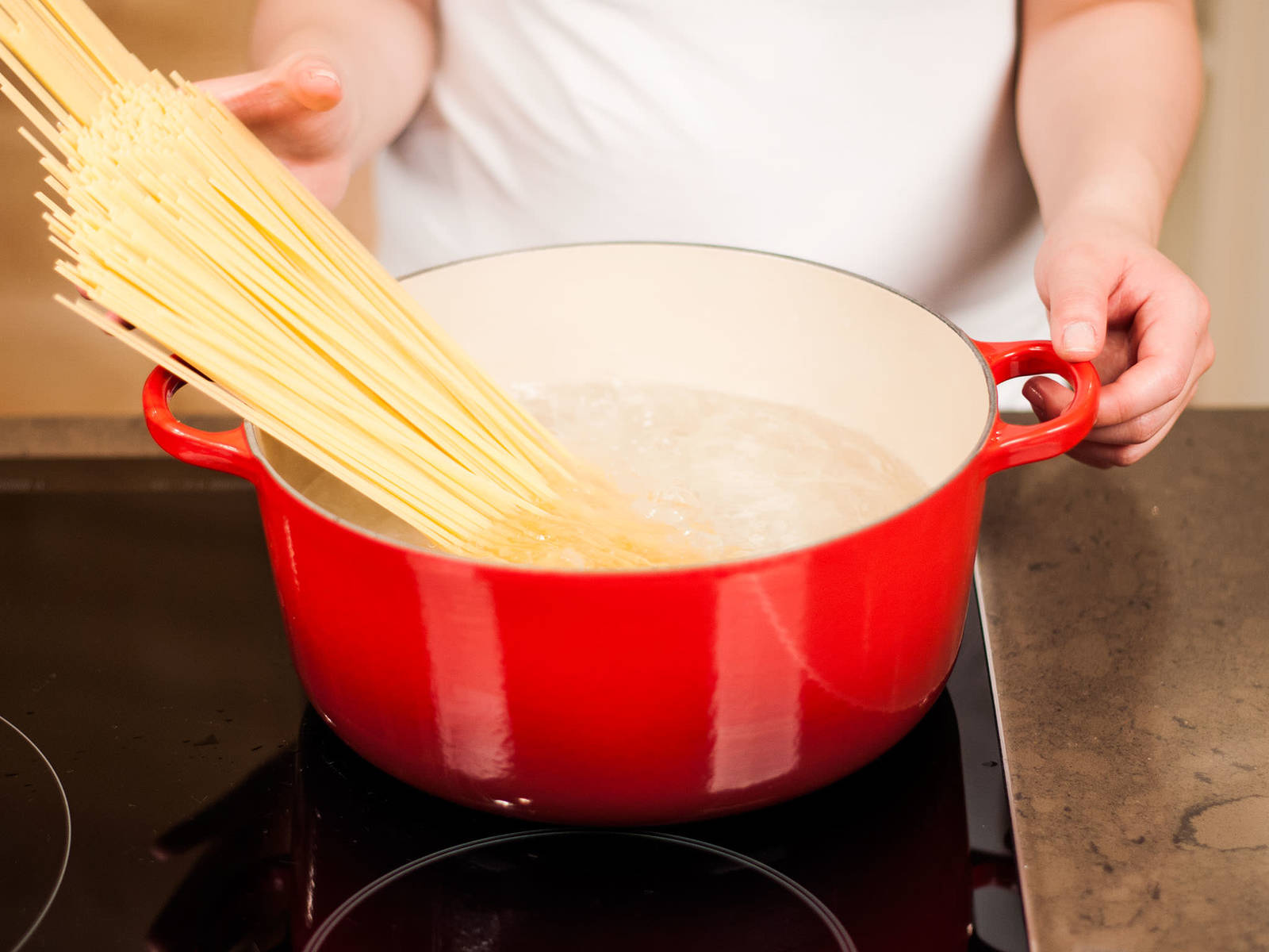 In the meantime, cook pasta in plenty of salted boiling water according to package instructions for approx. 10 - 12 min. until al dente. Drain, top with sauce, and serve with grated Parmesan.