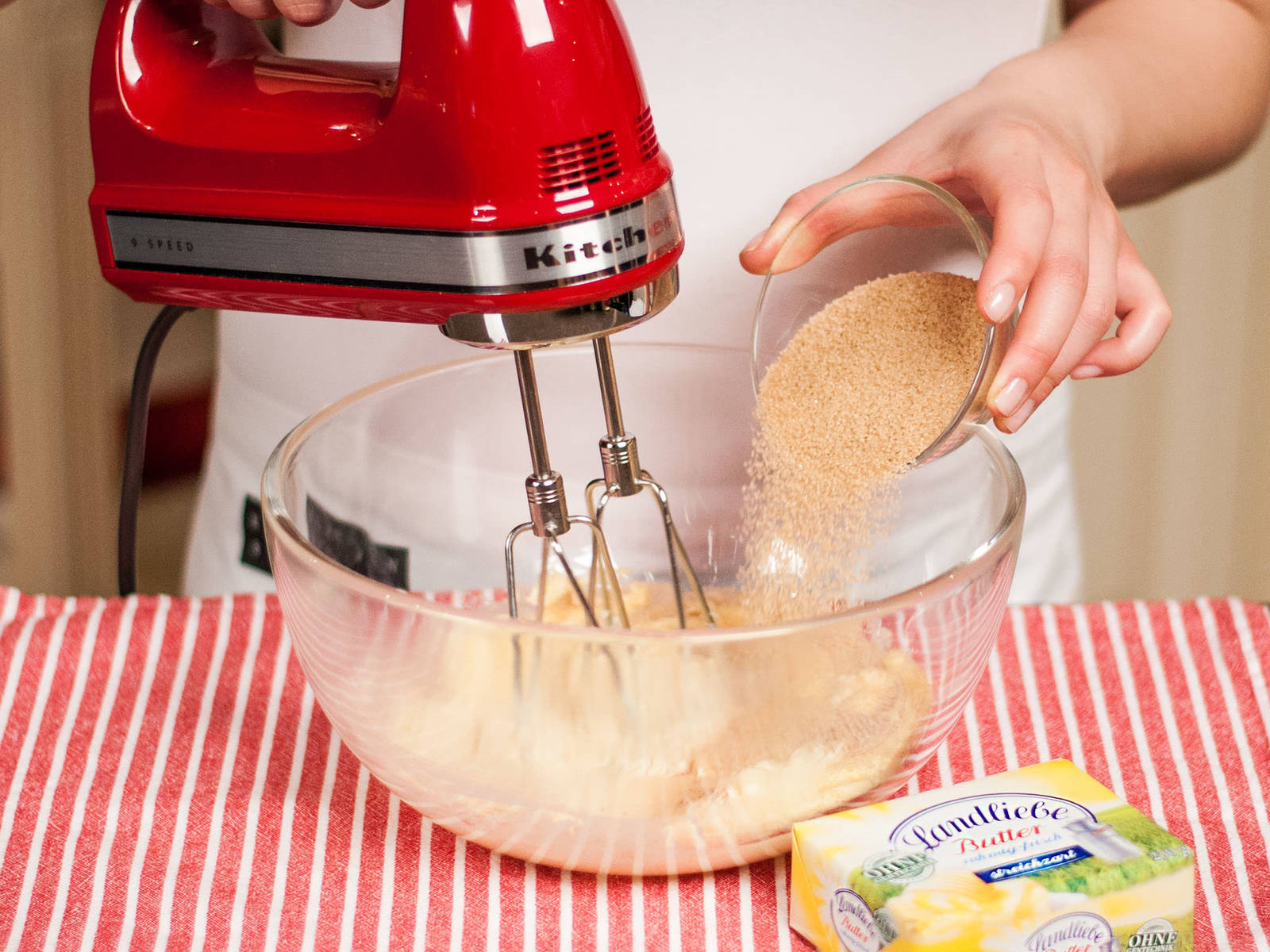 In another bowl, beat soft butter, brown sugar, and vanilla sugar until fluffy and pale.
