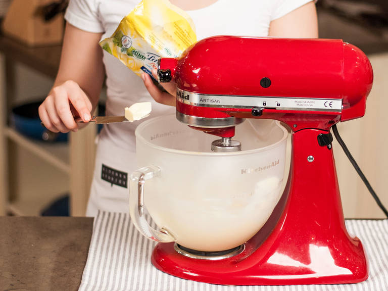 In a standing mixer, or with a hand mixer with beaters, beat soft butter and brown sugar until pale and fluffy. Blend in two-thirds of the vanilla extract.