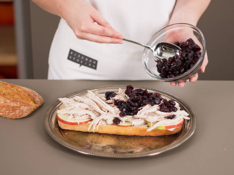 Slather mayonnaise on bottom half of ciabatta. Distribute apple slices and turkey. Drape cranberry sauce over the top, cover with top half of ciabatta, and enjoy!