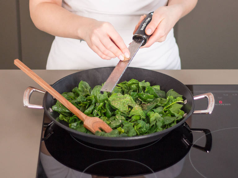In a frying pan, sauté the spinach until wilted. Season to taste with nutmeg, salt, and pepper. Set aside.