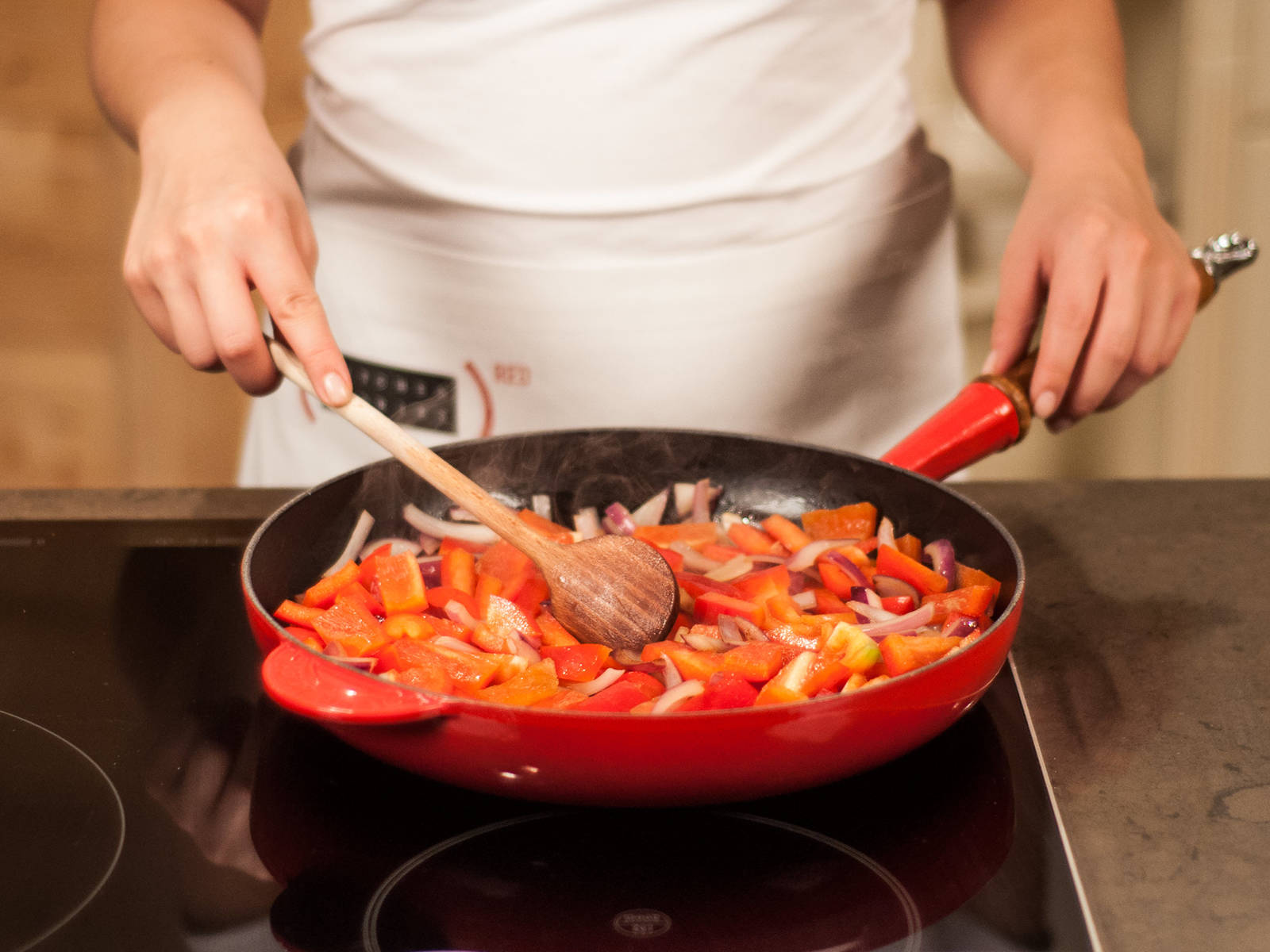 Heat up some peanut oil in a large frying pan. Sauté chopped onion, garlic, and bell pepper until slightly softened.