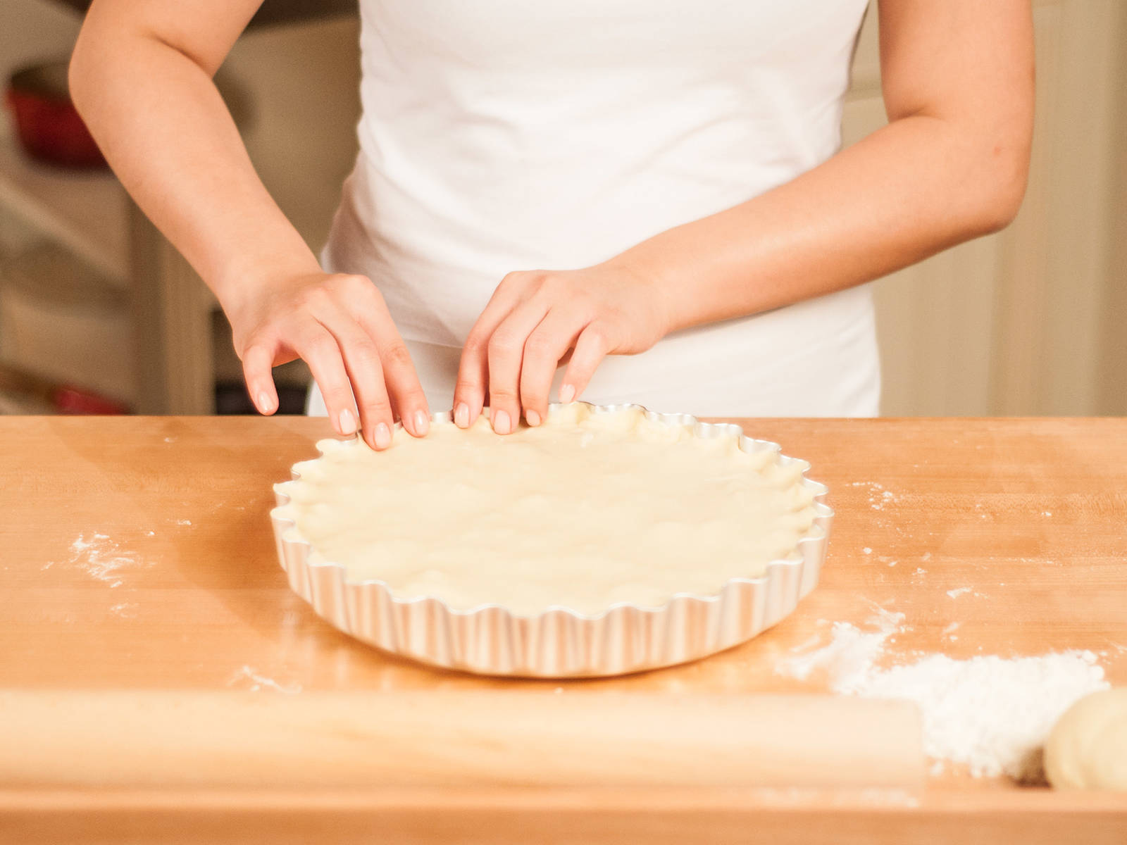 Cover the pie with the prepared top crust. Trim the excess leaving an overhang of approx. 1cm. Crimp overhang to seal the pie.