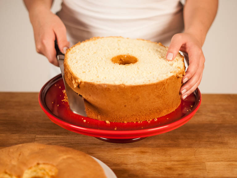 Slide a paring knife around edges of tube and side of pan. Carefully release the cake. Cut cake horizontally into 3 layers with a serrated knife.