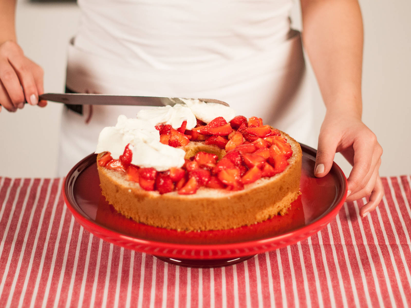 Transfer bottom layer to a cake plate or platter. Spread with half the berries and drizzle with juices. Spread half the whipped cream over berries, then top with middle cake layer.