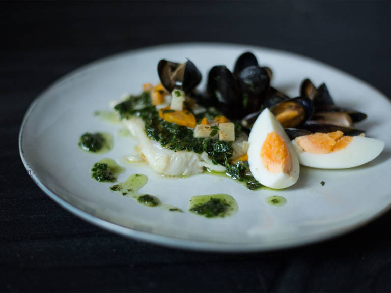 Shortly before the hake is cooked, add the mussels to the pan to warm before serving. To serve, pour over the salsa verde, quarter the hard-boiled eggs and arrange around the hake. Enjoy!