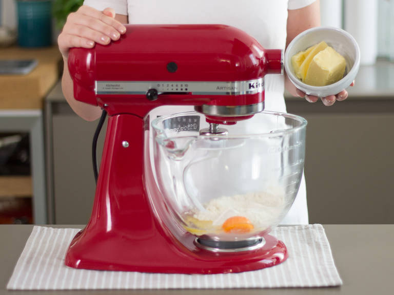 Add flour, butter, a pinch of salt, and a part of the eggs to a standing mixer. Knead until a smooth dough forms.