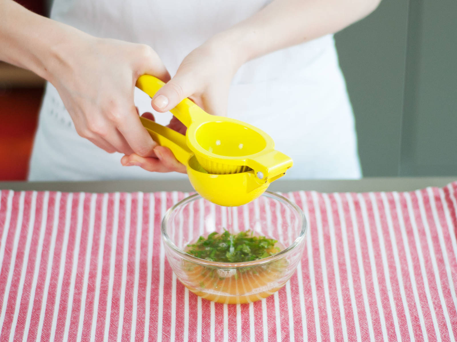 In a small bowl, whisk together grapefruit juice, orange juice, lime juice, lime zest, olive oil, honey, and chopped mint.