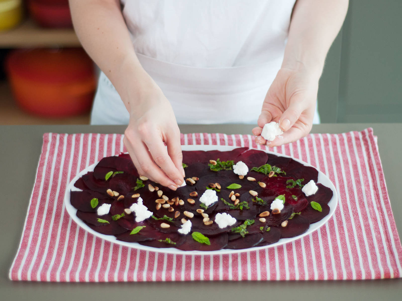 Arrange beets in an even layer on a plate. Pour vinaigrette over beets, add salt and pepper to taste, and garnish with pine nuts, goat cheese, and remaining mint leaves. Enjoy!