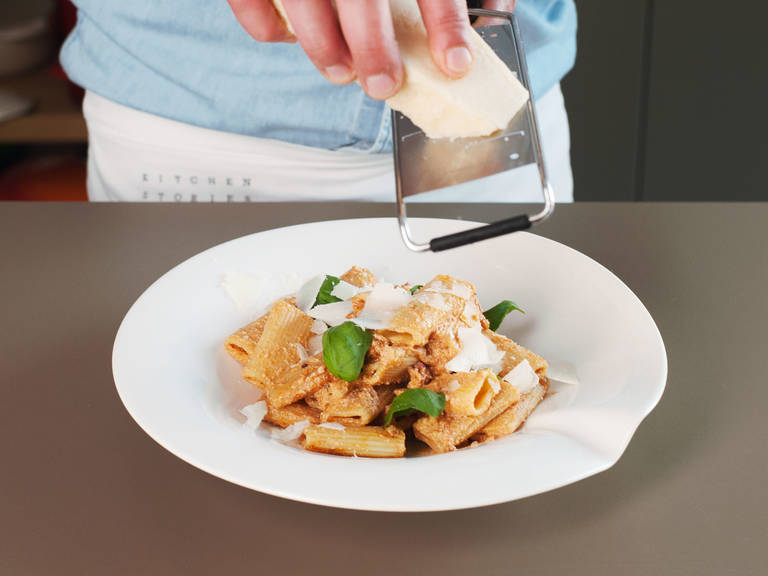 Toss rigatoni with tomato sauce. Season to taste with salt and pepper. Serve with grated Parmesan, fresh basil, and a drizzle of high quality olive if desired. Enjoy!
