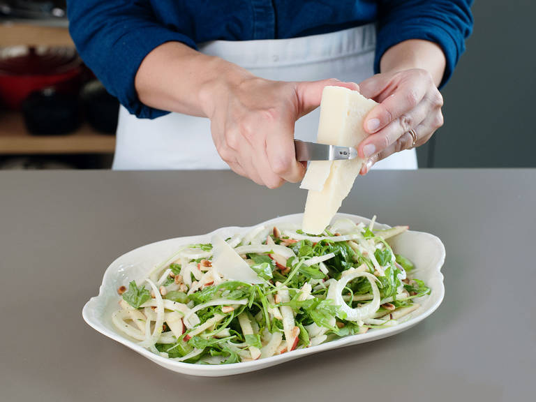 Transfer salad to a serving platter and garnish with shavings of pecorino, pine nuts, and chopped tarragon. Enjoy!