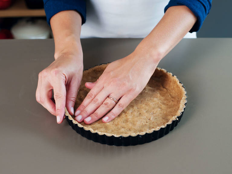 Turn dough out onto a lightly floured surface and knead a couple of times until the dough is smooth. Reserve a third of the dough for the topping and press the remaining dough evenly into tart pan, making sure to press it up the sides and into corners.